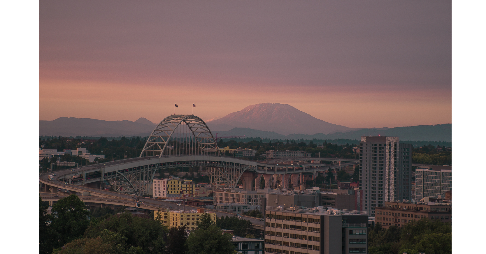 Image of bridge in Portland with Mt Saint Helens in the background
