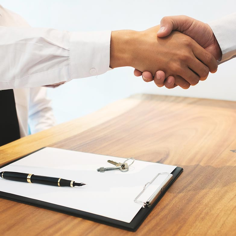Photo of a tax consultant shaking a client's hand